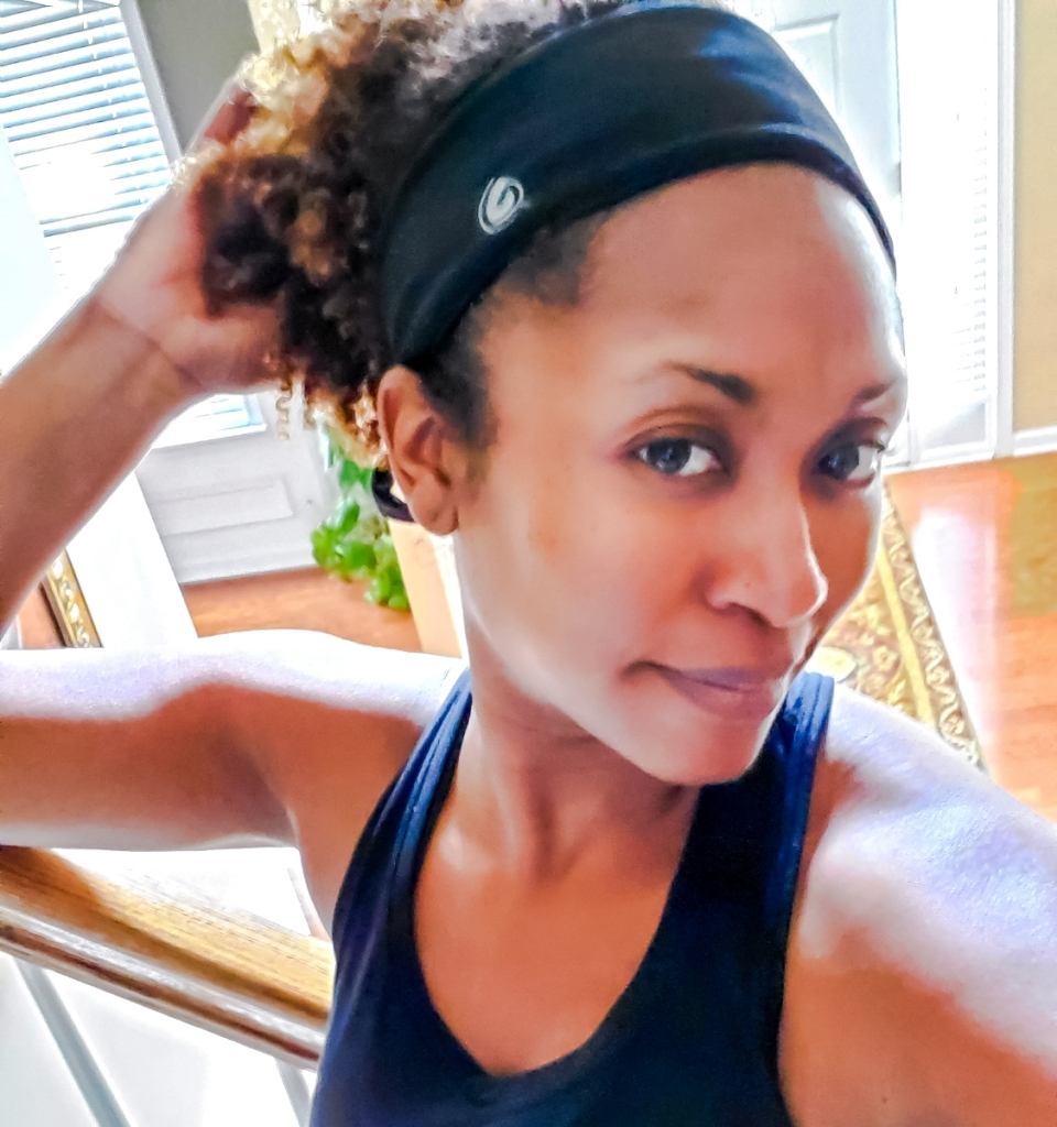 African American woman wearing a black Gymwrap workout headband
